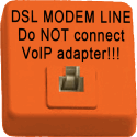Telephone jack painted orange with label 'DSL MODEM LINE - Do NOT connect VoIP adapter'